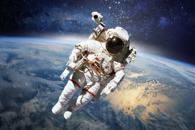 Poster Astronaut in outer space with planet earth as backdrop. Elements