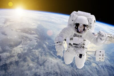 Poster Astronaut in Space, in background our earth an the sun - Elements of this image furnished by NASA