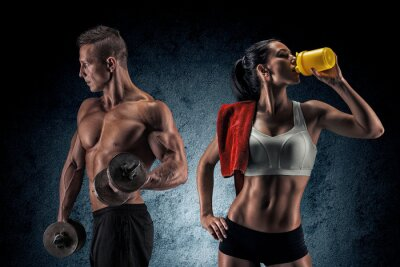 Poster Athletic man and woman with a dumbells.