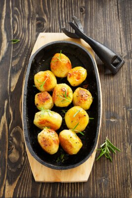 Poster Baked potatoes with rosemary.