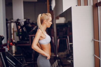 Poster Beautiful blonde doing gym exercises