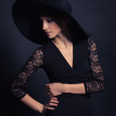 Poster beautiful girl in black dress and hat