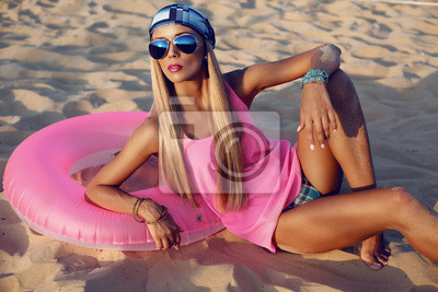 Poster Beautiful girl with blond hair on the beach