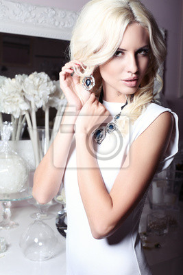 Poster Beautiful girl with blond hair with jewellery