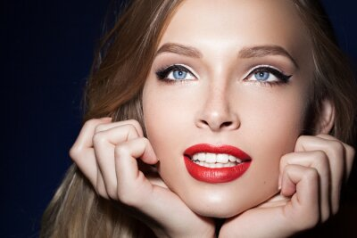 Poster beautiful girl with red lips with hands near the face