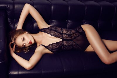 Poster beautiful sensual girl with long dark hair wearing luxurious lace lingerie