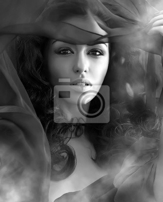 Beautiful sexy woman in clubs of a smoke