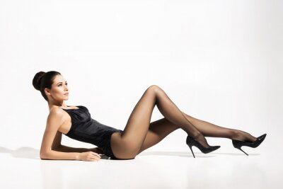 Poster Beautiful, slim lady wearing provocative pantyhose over white background.