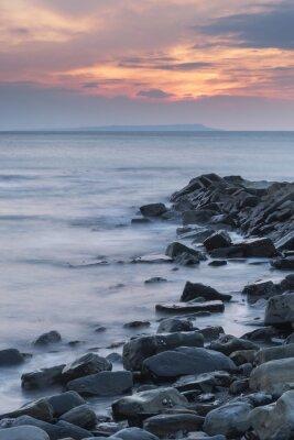 Poster Beautiful sunset landscape image of rocky coastline in Kimmeridg