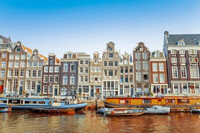 Poster Beautiful view of Amsterdam canals with bridge and typical dutch