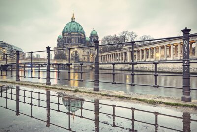 Poster Berlin Cathedral (Berliner Dom) and Museum Island (Museumsinsel) reflected in puddle, Berlin, Germany, Europe, vintage filtered style