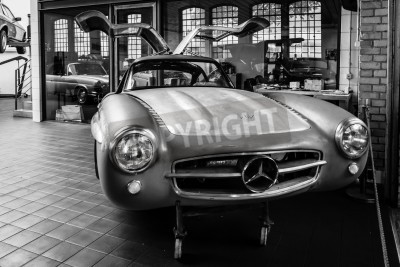 Poster BERLIN, GERMANY - MAY 17, 2014: Body Mercedes-Benz 300SL (W198) in the restoration workshop of Mercedes-Benz. Black and white. 27th Oldtimer Day Berlin - Brandenburg
