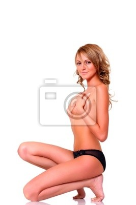 Blonde is kneeling and covers with hands a breast.
