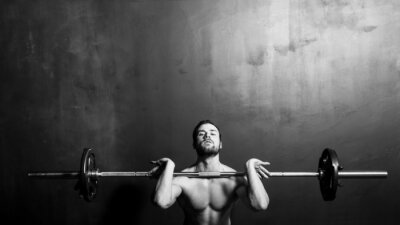 Poster Bodybuilding, Young Athletic Strong Man Weightlifting , Black and White in studio