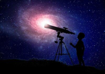 Poster Boy looking through a telescope