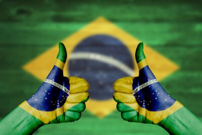 Poster Brazil flag painted on female hands thumbs up