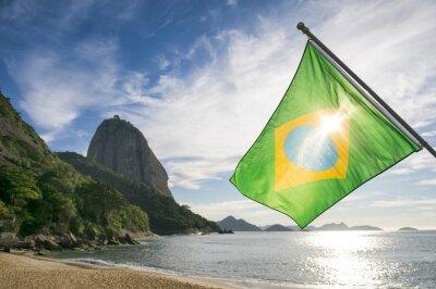 Poster Brazilian flag at Praia Vermelha Red Beach with a sunrise view of Sugarloaf Mountain Pao de Acucar in Rio de Janeiro Brazil