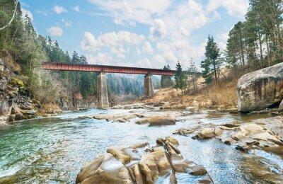 Poster bridge on the mountain river