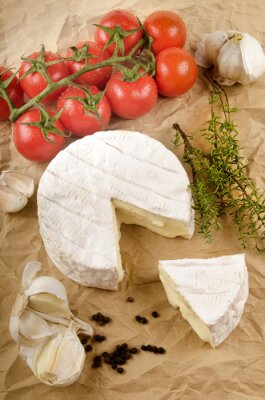 Poster camembert with garlic, black pepper, tomato and thyme on brown p