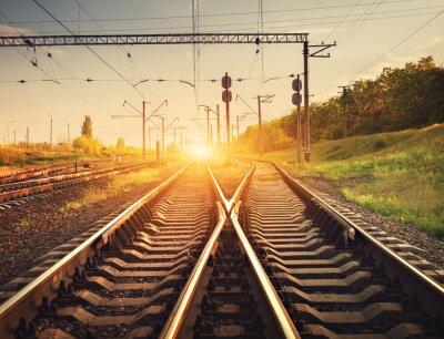 Poster Cargo train platform at sunset. Railroad in Ukraine. Railway sta