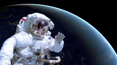 Poster Close up of an astronaut in outer space, earth by night in the background. Elements of this image are furnished by NASA