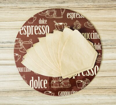 Poster Coffee themed round tray and coffee filters on the wooden backgr