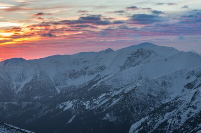 Poster Colorful mountain sunset panorama at winter in Western Tatras