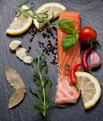 Poster Delicious portion of fresh salmon fillet with aromatic herbs, spices and vegetables - healthy food, diet or cooking concept
