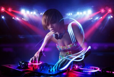 Poster Disc jockey girl playing music with light beam effects on stage