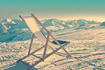 Poster Empty deckchair on the side of a ski slope, vintage process