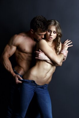 Poster Erotica. Passionate muscular guy strips sexy girl