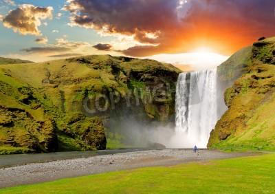 Poster famous waterfall Skogafoss in Iceland at sunset