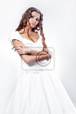 Fashion bride wearing wedding dress with winter snow