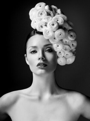 Poster fashion model with large hairstyle and flowers in her hair.