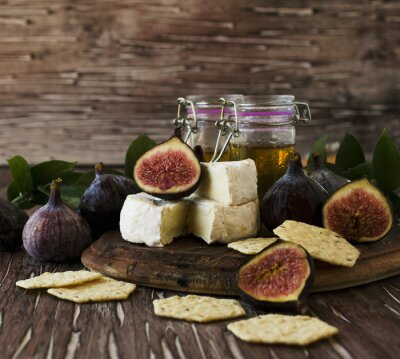 Poster figs with cheese and honey , selective focus