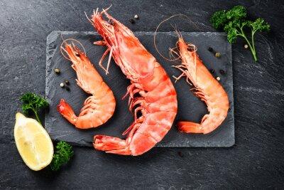 Poster Fine selection of jumbo shrimps for dinner on stone plate