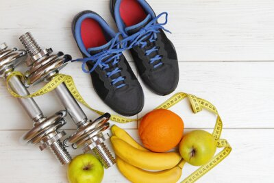 Poster fitness equipment and healthy nutrition on white wooden plank fl