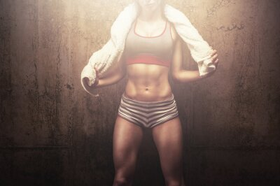 Poster Fitness woman after hard workout training holding white sports towel