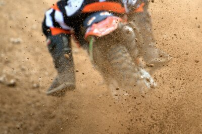 Poster Flying debris from a motocross in dirt track