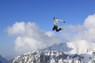 Poster Flying snowboarder on mountains. Extreme sport.