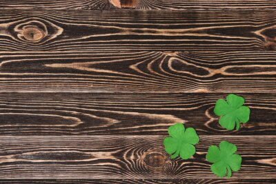Poster Four leaf clovers on wooden background