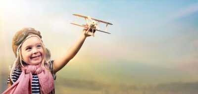 Poster Freedom To Dream - Joyful Child Playing With Airplane Against The Sky
