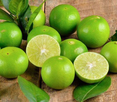 Poster Fresh lime  on wooden  background