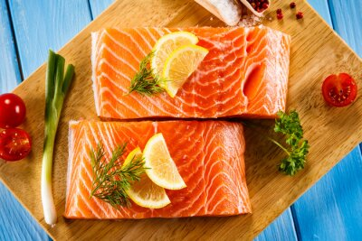 Poster Fresh raw salmon fillets on cutting board