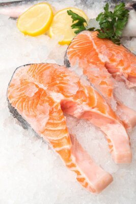 Poster Fresh salmon fish with lemon at market