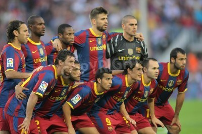 Poster Futbol Club Barcelona Team before the match between FC Barcelona and Mallorca in Nou Camp Stadium in Barcelona, Spain. October 3, 2010