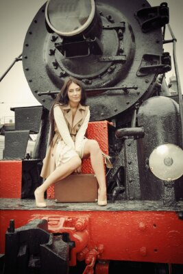 Poster girl sitting on a vintage train