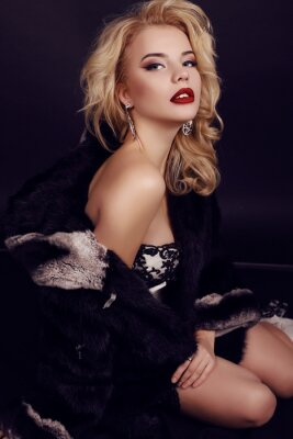 Poster gorgeous woman with blond hair wears luxurious dress,fur and bijou