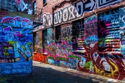Poster Graffiti on walls in Graffiti Alley, Baltimore, Maryland.
