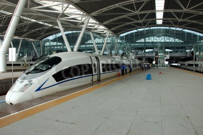 Poster GUANGZHOU, CHINA - SEPTEMBER 29: China invests in fast and modern railway, trains with speed over 340 km/h. Train to Wuhan on September 29, 2010 waits in newly build Guangzhou South station.